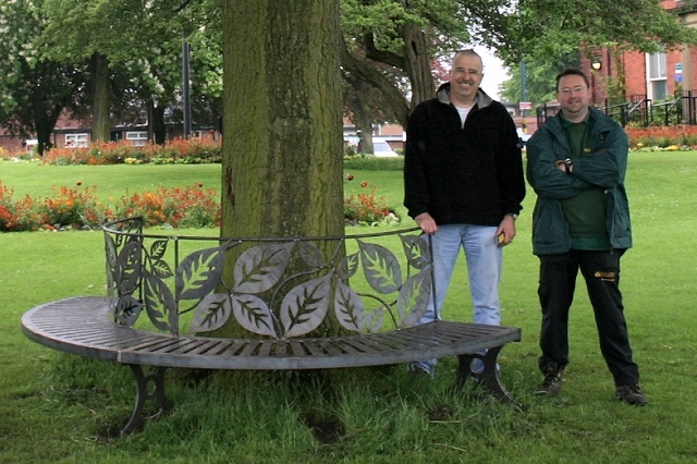 drian Ellis, Park Manager (right), and Mark Whittaker of the Friends of Memorial Park pose with one half of the bench in situ.